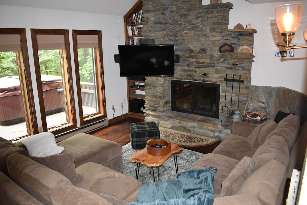Main living room with fieldstone fireplace and views