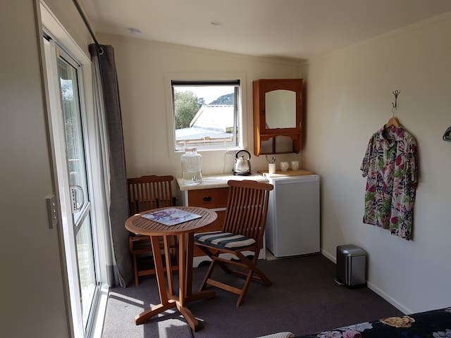 The cabin kitchenette with table, chairs etc
