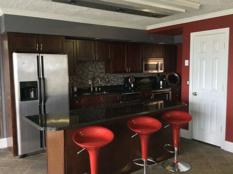 Kitchen, appliances, island with bar stools