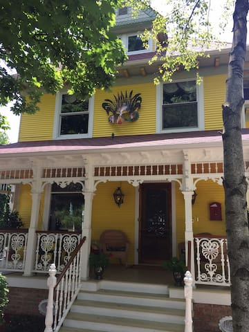 Note the Mardi Gras mask on the second floor. Gas lights are mounted on the front porch