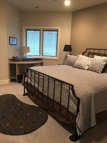 The Joe Room with a king size bed, desk and walk in closet on the lower level
