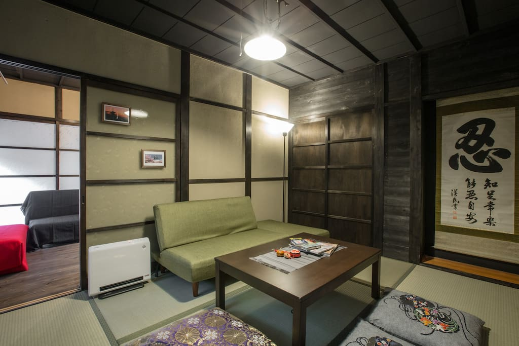 Remodeled house is very nice and clean.Living room.he tatami room there is a sofa bed and tableware.