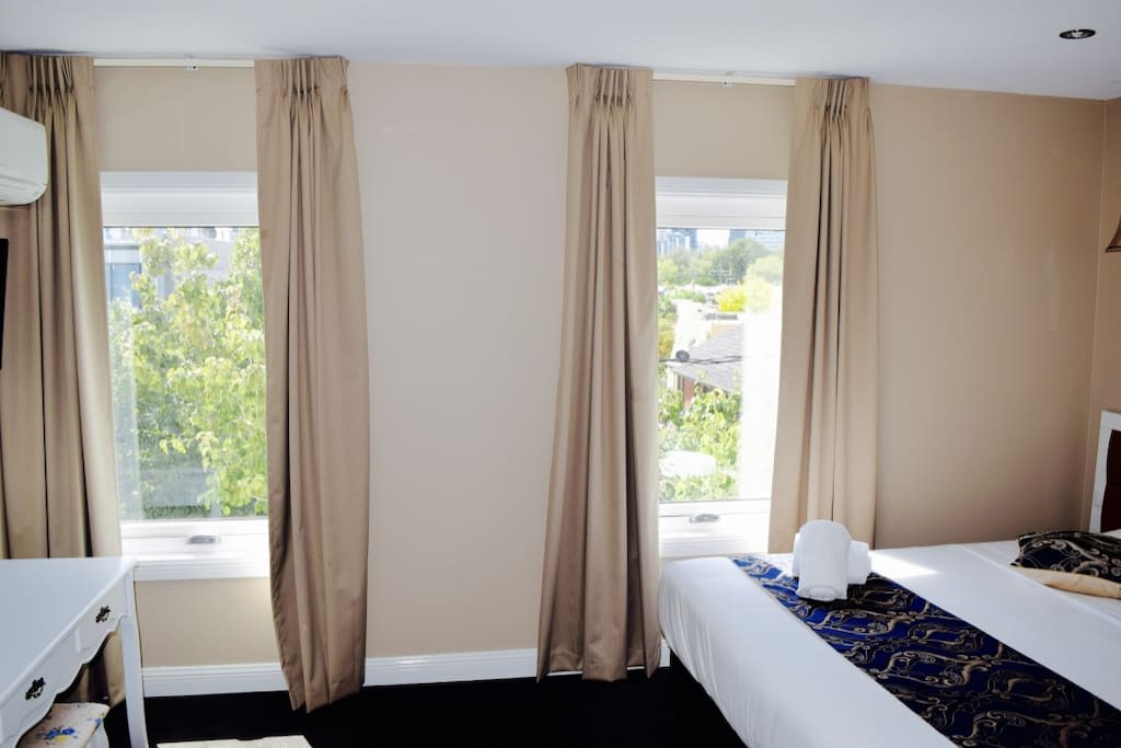 Floor to ceiling sun block curtains