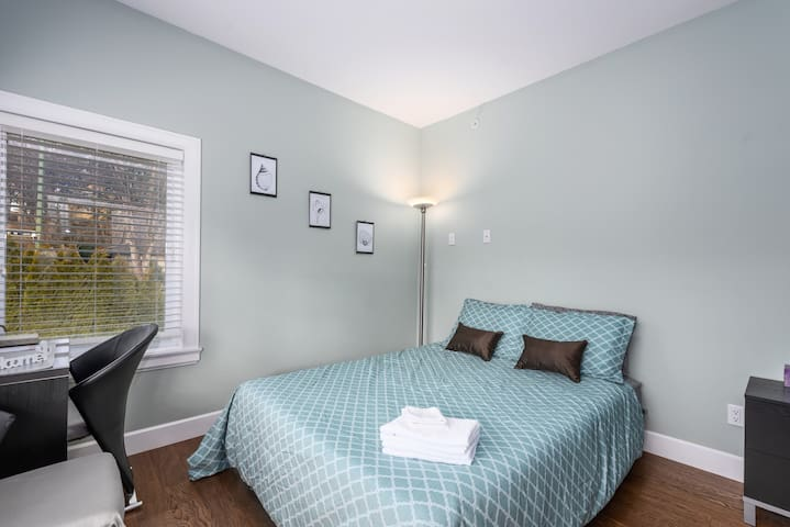 This spacious room invites you to a comfortable rest.  The queen-sized bed has storage drawers.