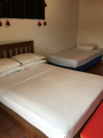 Bedrooms have one full bed + 1 single bed in each room