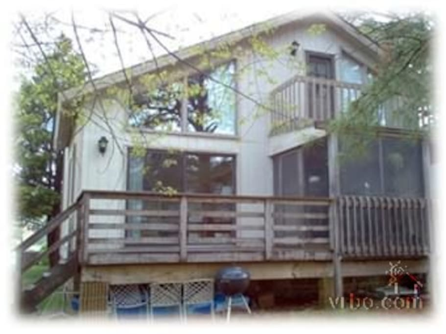Rear deck and screened porch overlooking canal