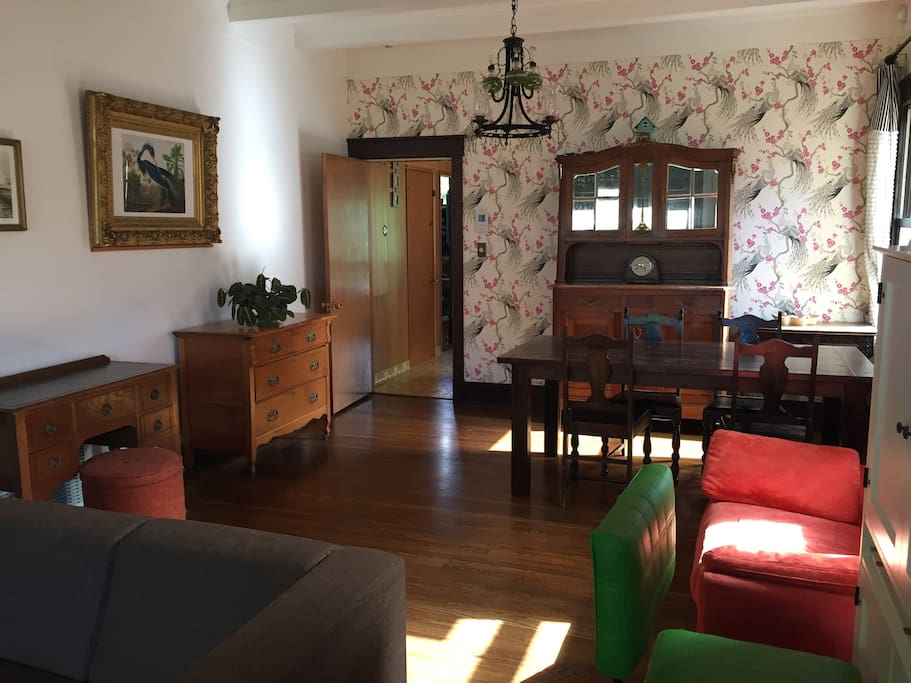 Spacious Living/Dining Room with European antiques
