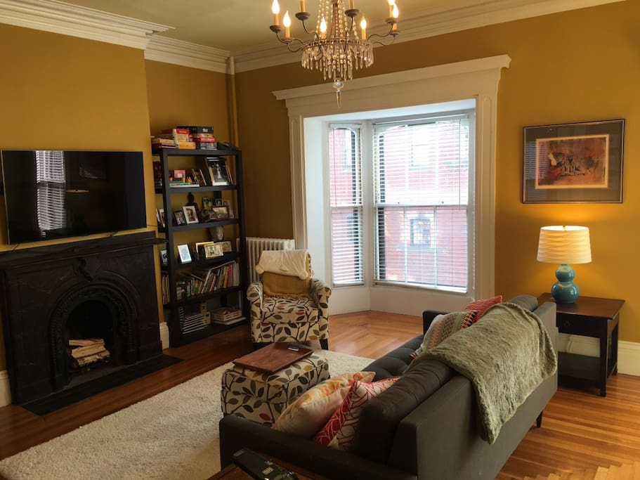 Parlor living room with high 11-foot ceiling and bay windows with lots of natural light