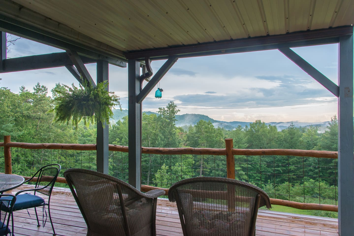 Relaxing back deck with lovely view.