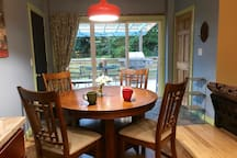 Dining area. Table expands and there is storage space in the base of the table that has cloth napkins stored.