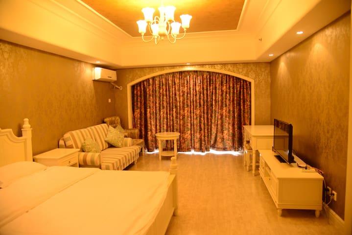 北戴河黄金海岸高尔夫球场私属海滩园景海景高端公寓1004 - Qinhuangdao - Daire
