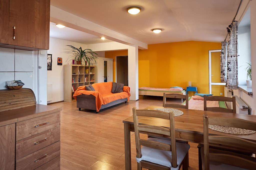 Living room. Two single beds for sleeping, sofa for sitting, kitchen table