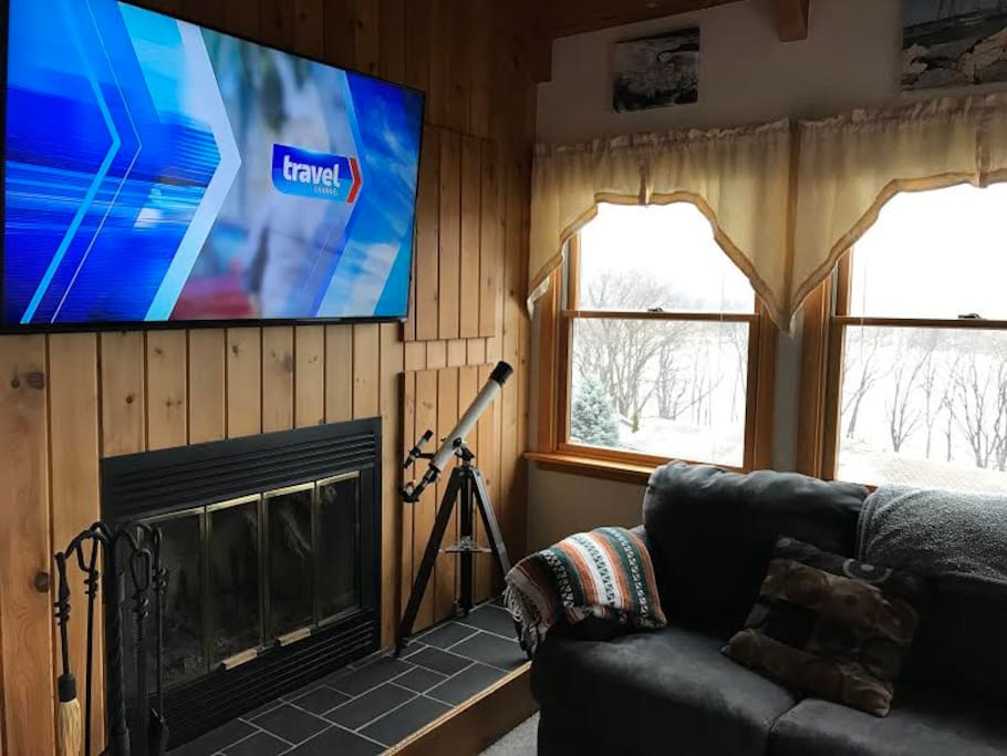 "Living room, with fireplace and 60"" HDTV"