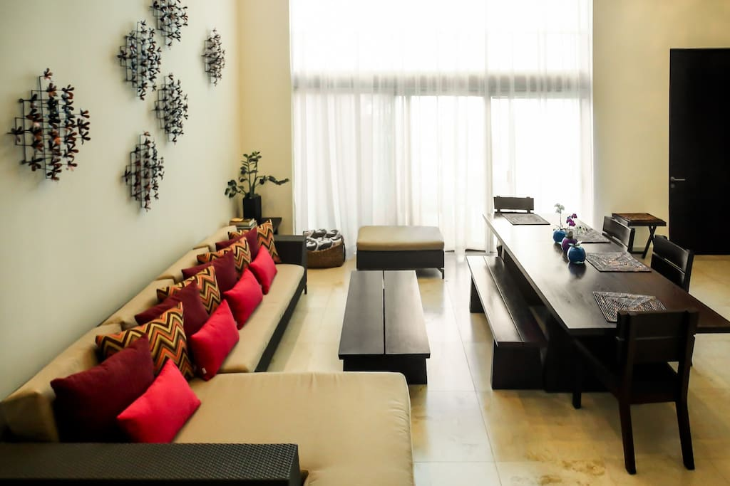 Living and dining area with arden and pool view