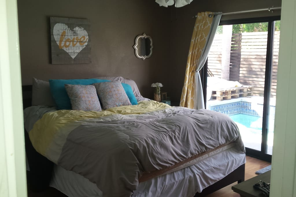 Room own private master bedroom with California king bed and private bathroom. Sliding glass door leads you directly out to the pool and backyard!