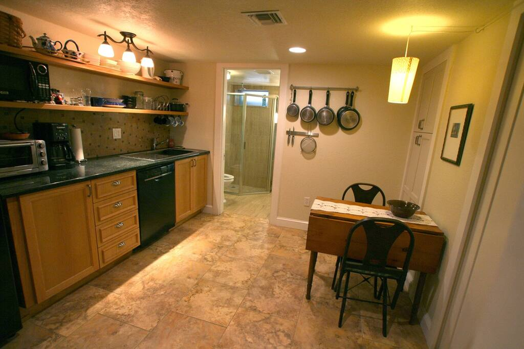 Kitchen with refrigerator/freezer, microwave, toaster oven, induction cook plate, dishwasher, etc.