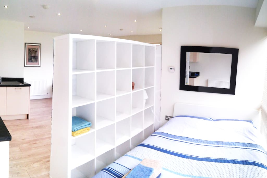 Your bedroom with a large king size bed for 2 people and a big shelve for your clothes