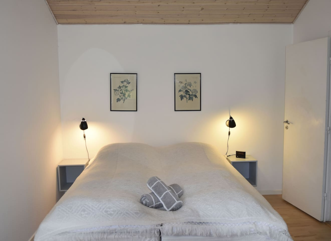 The room with a wide and comfortable double bed with elevation