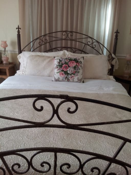 Queen bed with small desk for work or catching up with friends.