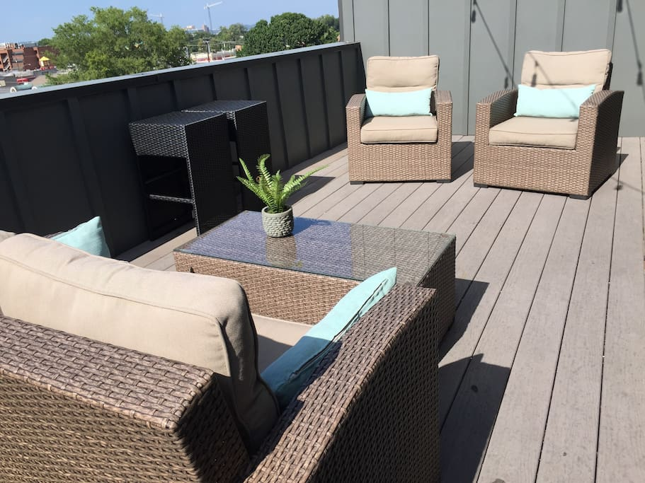 Enjoy morning coffee on the rooftop deck or a relaxing beverage under the glowing lights
