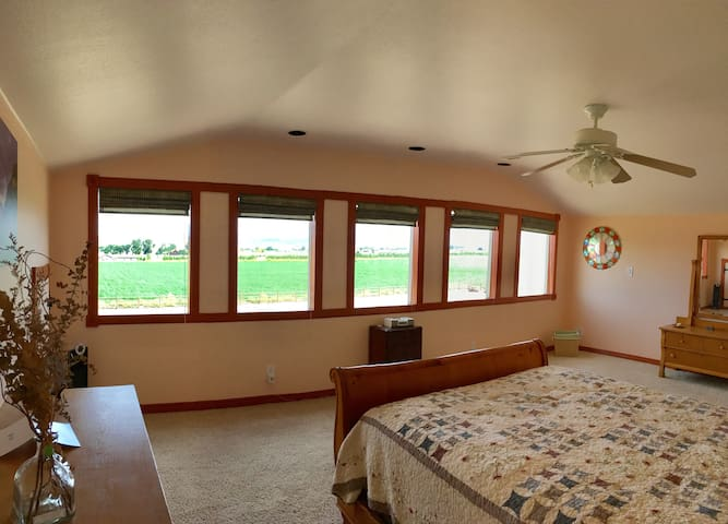 Master bedroom. Your bed faces east- catch breathtaking sunrises over the West Elk Mountains & the surrounding farm country.