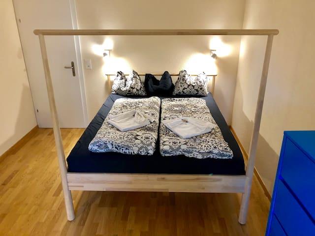 Main queen bed in main bedroom