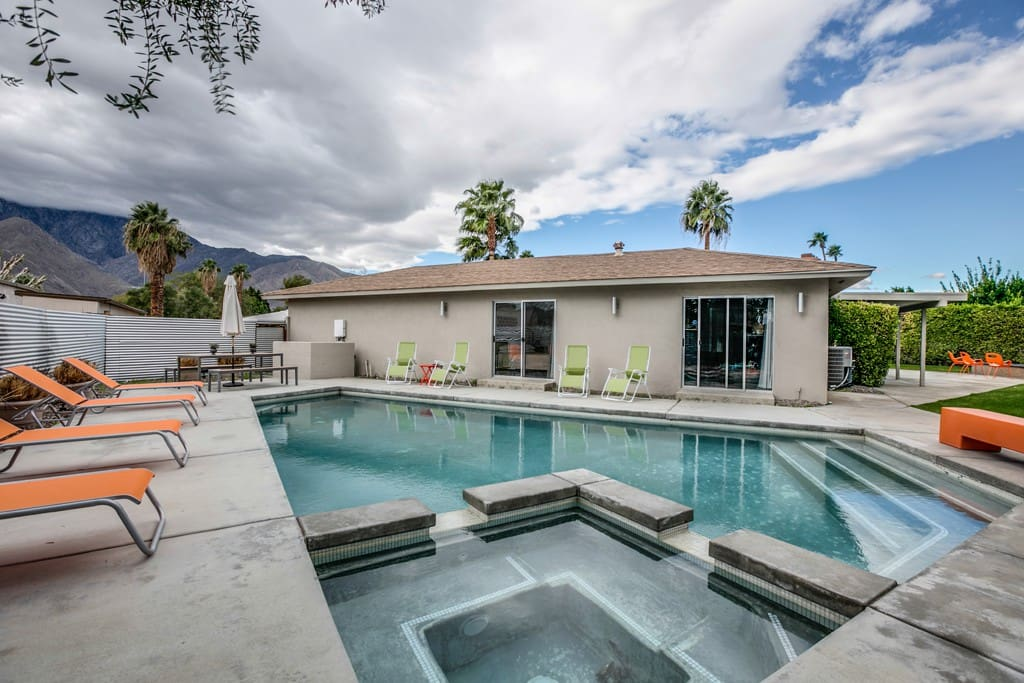 ACROSS POOL AND SPA - CASA BOREALIS - PALM SPRINGS VACATION RENTAL POOL HOME