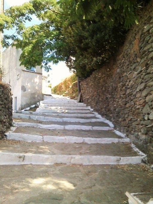 View of the path leading to Agios Artemios, the closest parking area.