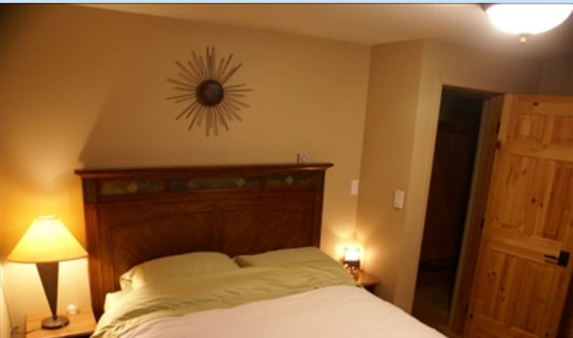 Queen bed in one bedroom with full closet and dresser.