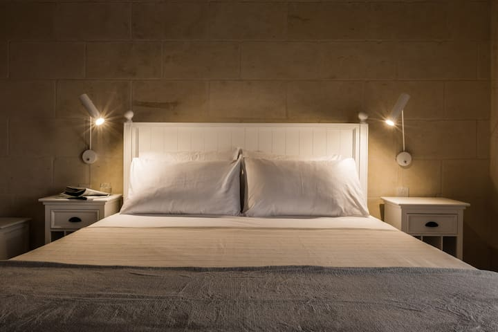 Double bed with bed-side reading lights