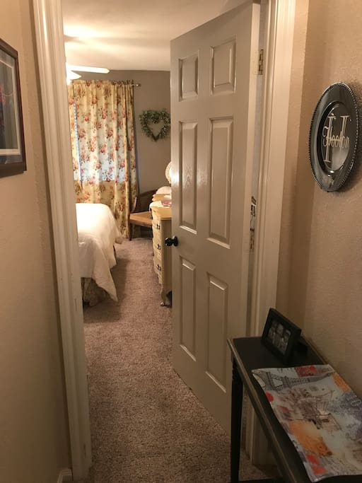 Entrance is at the end of a short hallway and next to shared bath.