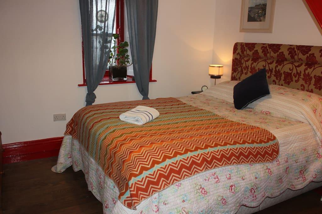 double bed in main bedroom