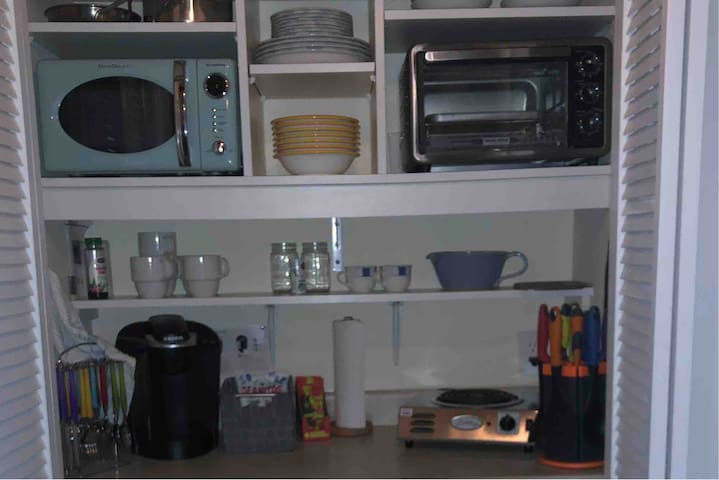 Kitchenette- complete with small fridge, large toaster oven, microwave, hot player, Keurig coffee maker, dishes, cooking utensils and cookware. There is also a shop sink in the half bathroom.