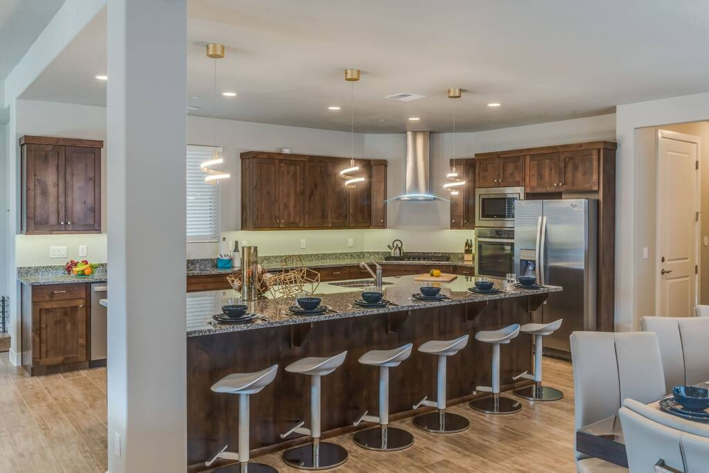 Custom kitchen with large island bar and bar seating for 6
