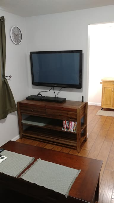 "40"" T.V. pulls out and rotates to allow viewing from bed."
