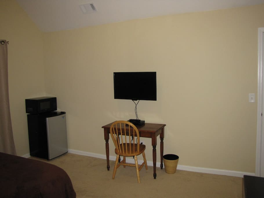 "Bedroom - Mini fridge and 32"" flat panel TV w/ cable"