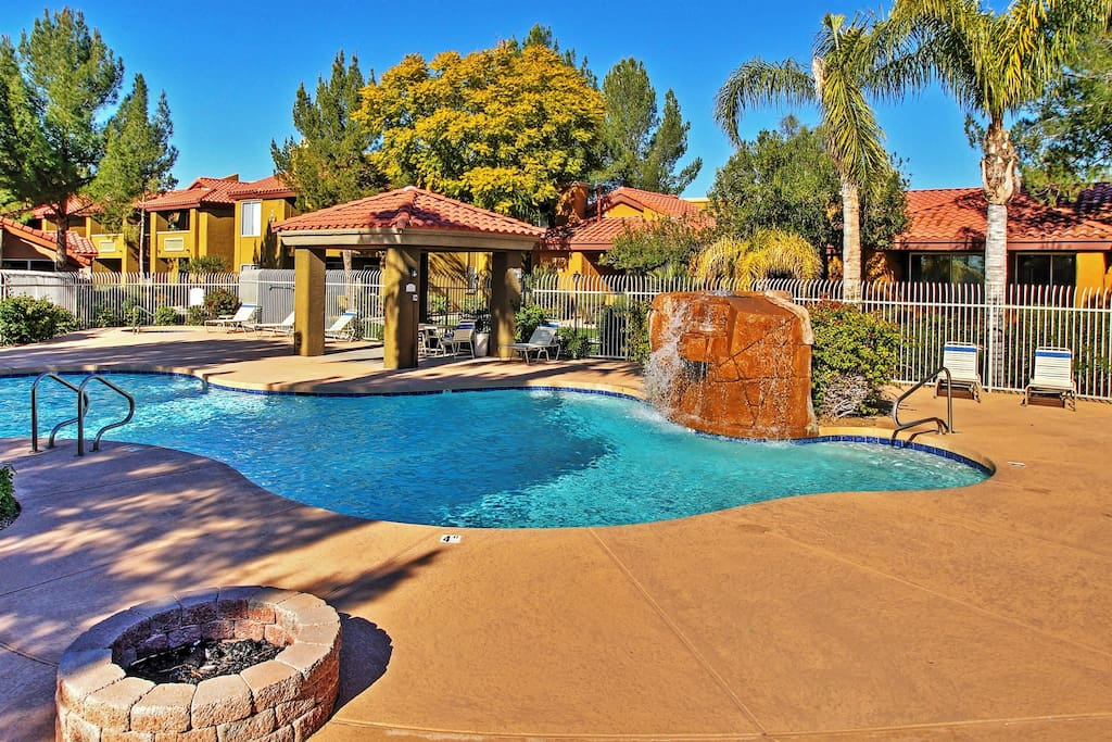 Look forward to leisurely days spent by the dazzling community swimming pool with waterfall