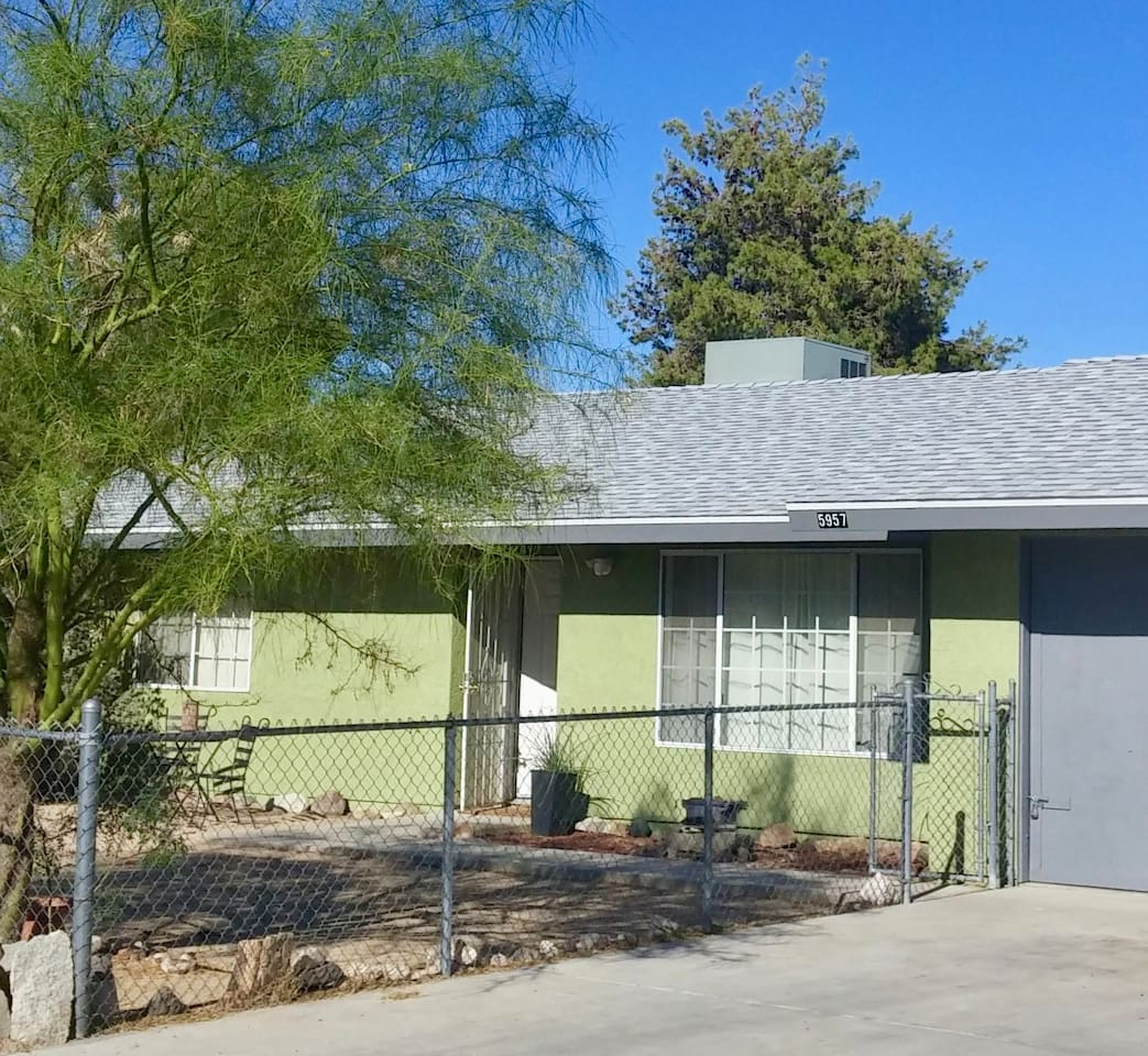 The Type Inn has been painted with retro sage green and new roof. Park in driveway and roll your stuff in... The fence goes all the around the front and back yards. Just be sure that both gates are closed before letting your pet out to run.