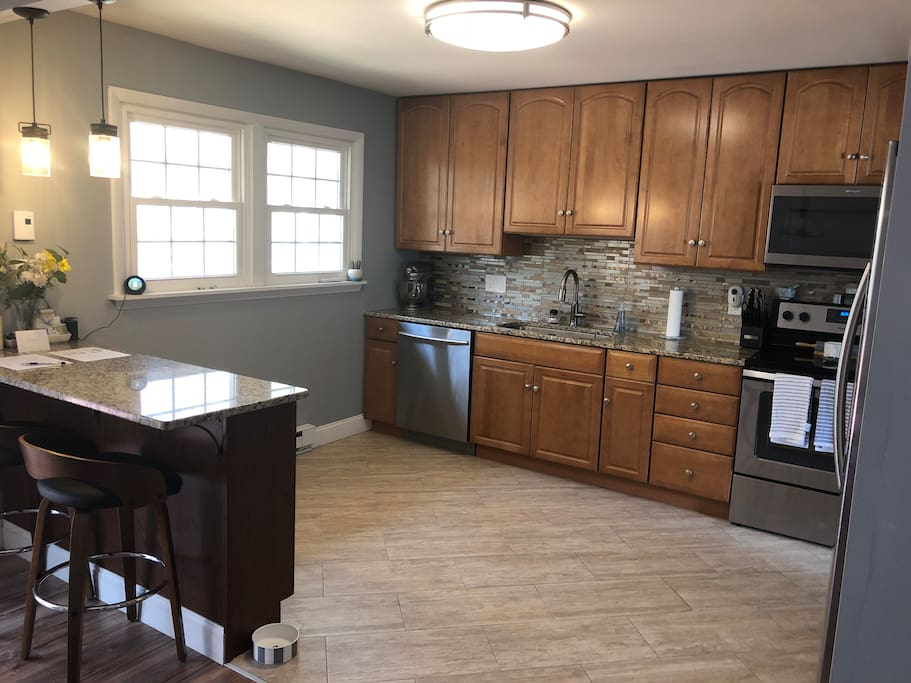Spacious kitchen with updated appliances. When you stay with us, we'll make sure you're covered on coffee and tea. We've also got a second fridge in the garage which is perfect for storing tailgate food/drinks.