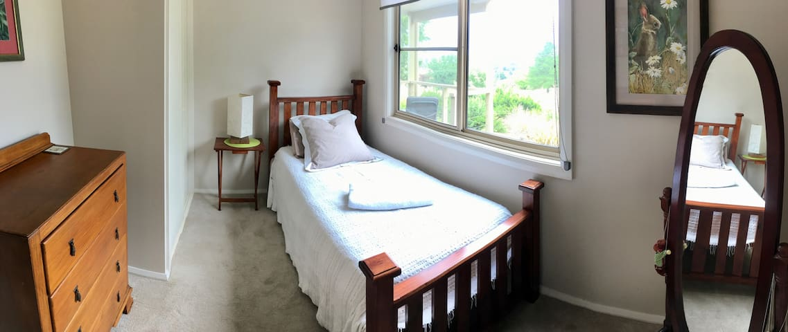 Comfortable, separate king single bedroom with built-in wardrobe.