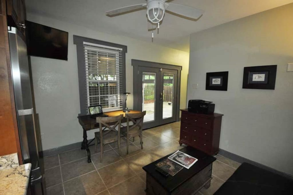 Desk can be converted to dining table. Nine foot ceilings through-out.