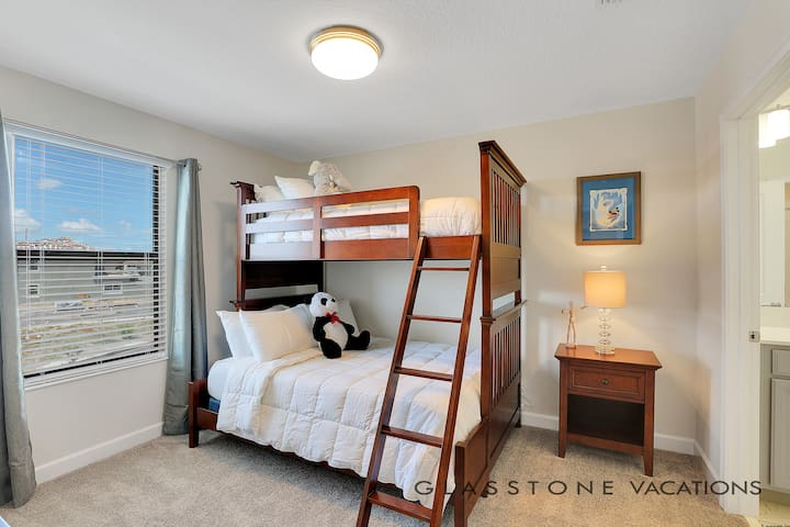 En-suite connecting kids room with a bunk bed with Full size and Twin size bed.