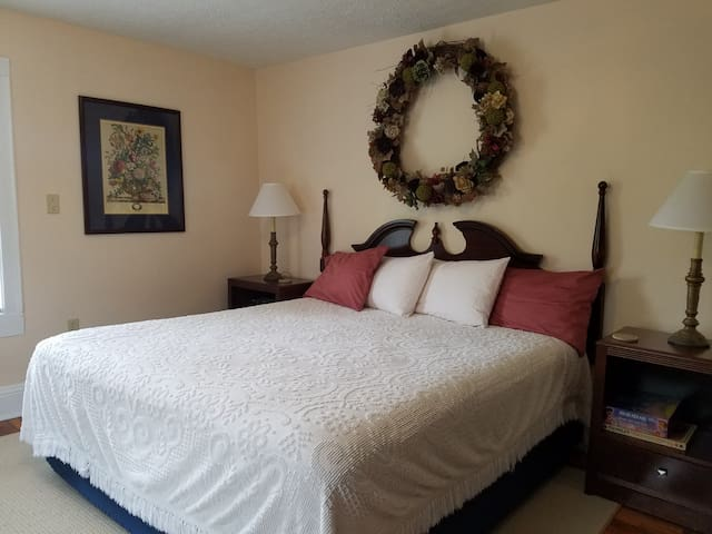 Master bedroom with extra fluffy mattress pad