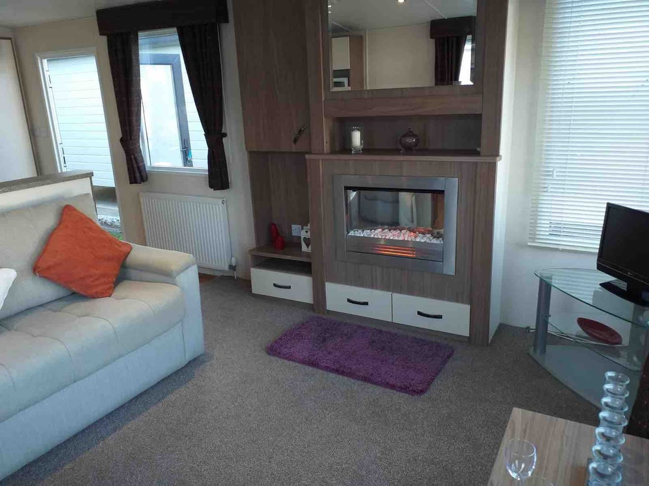Living Room, Lovely warm gas fire and gas central heating. TV and wonderful views. Five Minutes from the sea. Power shower gorgeous internals Great for after a day out onto beach walking .  Double bed two single beds comfortable holiday home