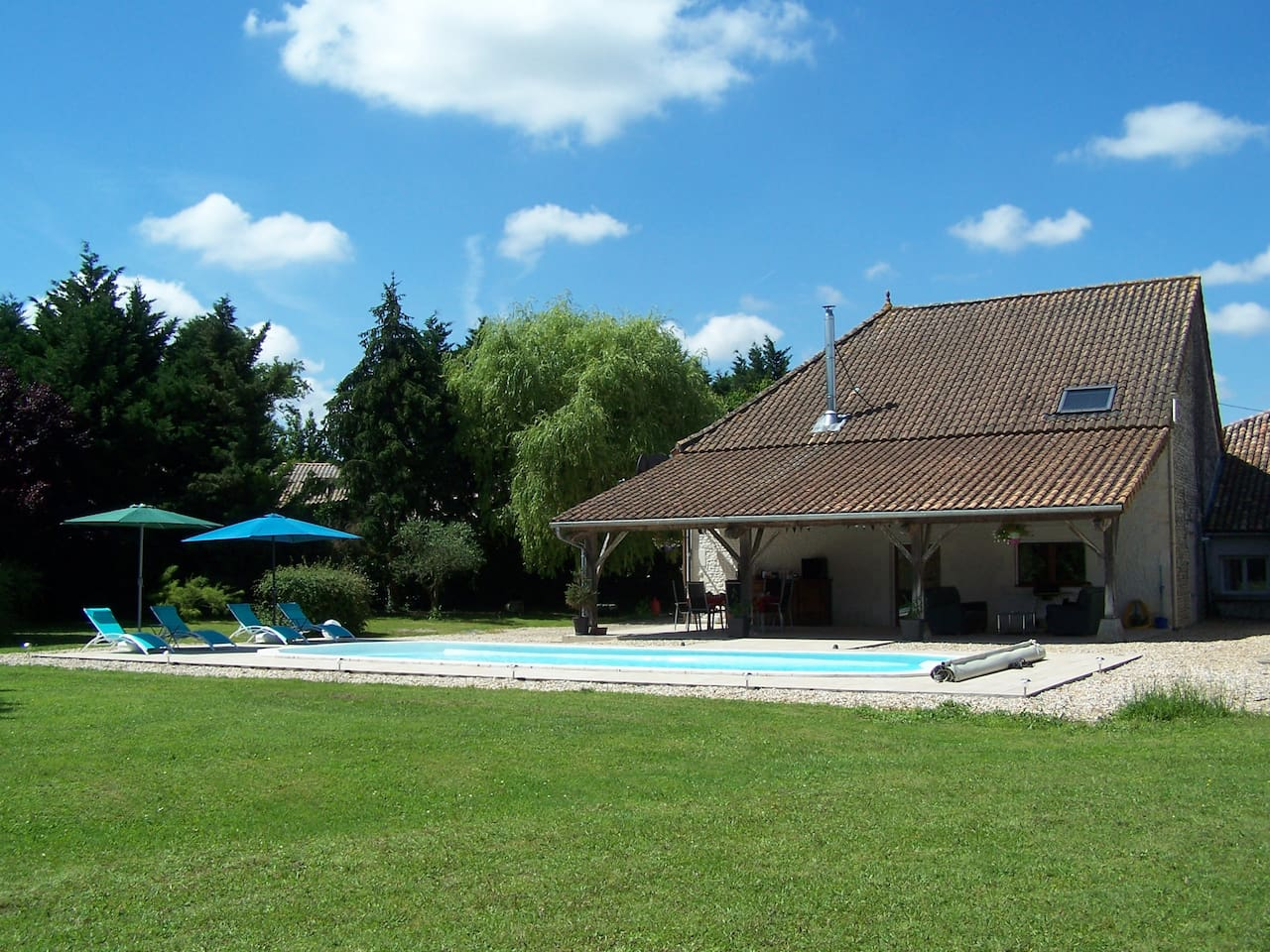 The heated pool and 2.5 acre (1 hectare) gardens