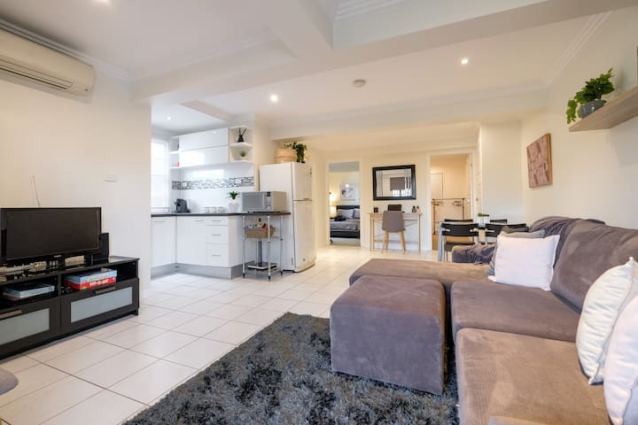 Open plan living/dining/kitchenette ( lounge converts to a double sofa bed)