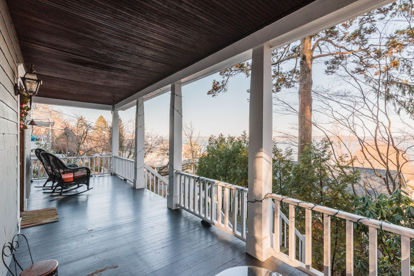 Rocking chairs.  Porch with views of Hudson River and Tappan Zee (Mario Cuomo) Bridge.