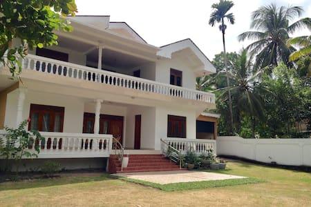 White villa A/C near airport 4 bdrs