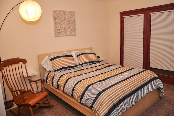 The master bedroom off of the great room has a queen bed