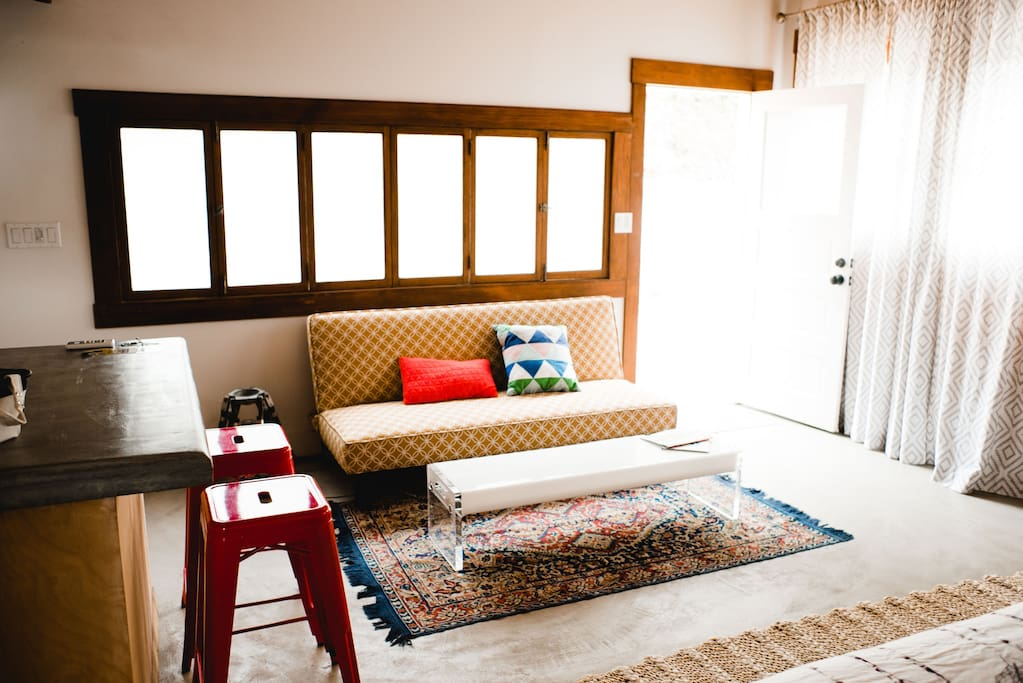 Sunny and spacious. The couch folds into an extra bed.